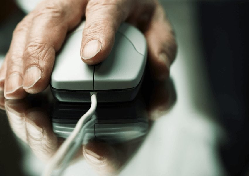 Hand using a wired mouse