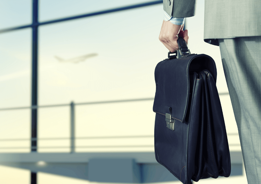 Man holding at airport, holding a bag