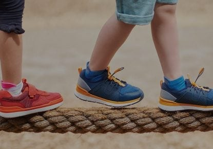 Two kids walking on rope with shoes