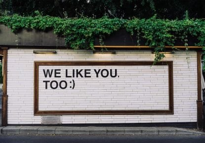 Wall with we like you too graffiti