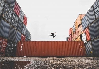 Man jumping on shipping container