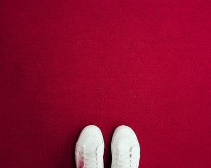 Red carpet with white Van shoes