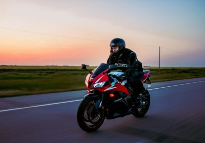 Man riding a red Honda CBR