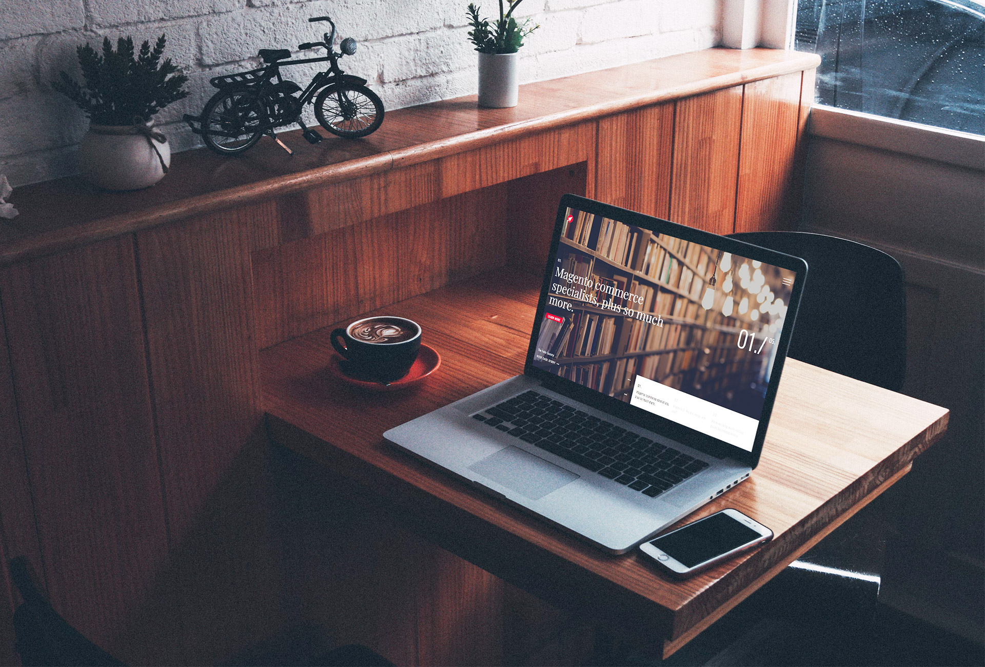 laptop on wooden table, with cup of coffee and mobile phone