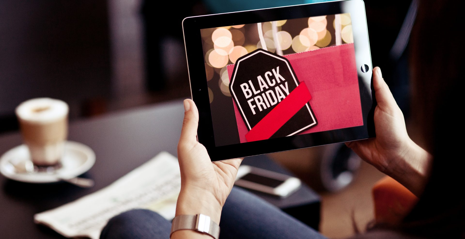 A person using a tablet to look at Black Friday deals.