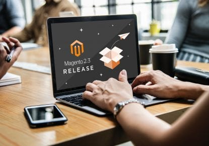Magento 2.3 Release splashscreen, on a laptop on a wooden table