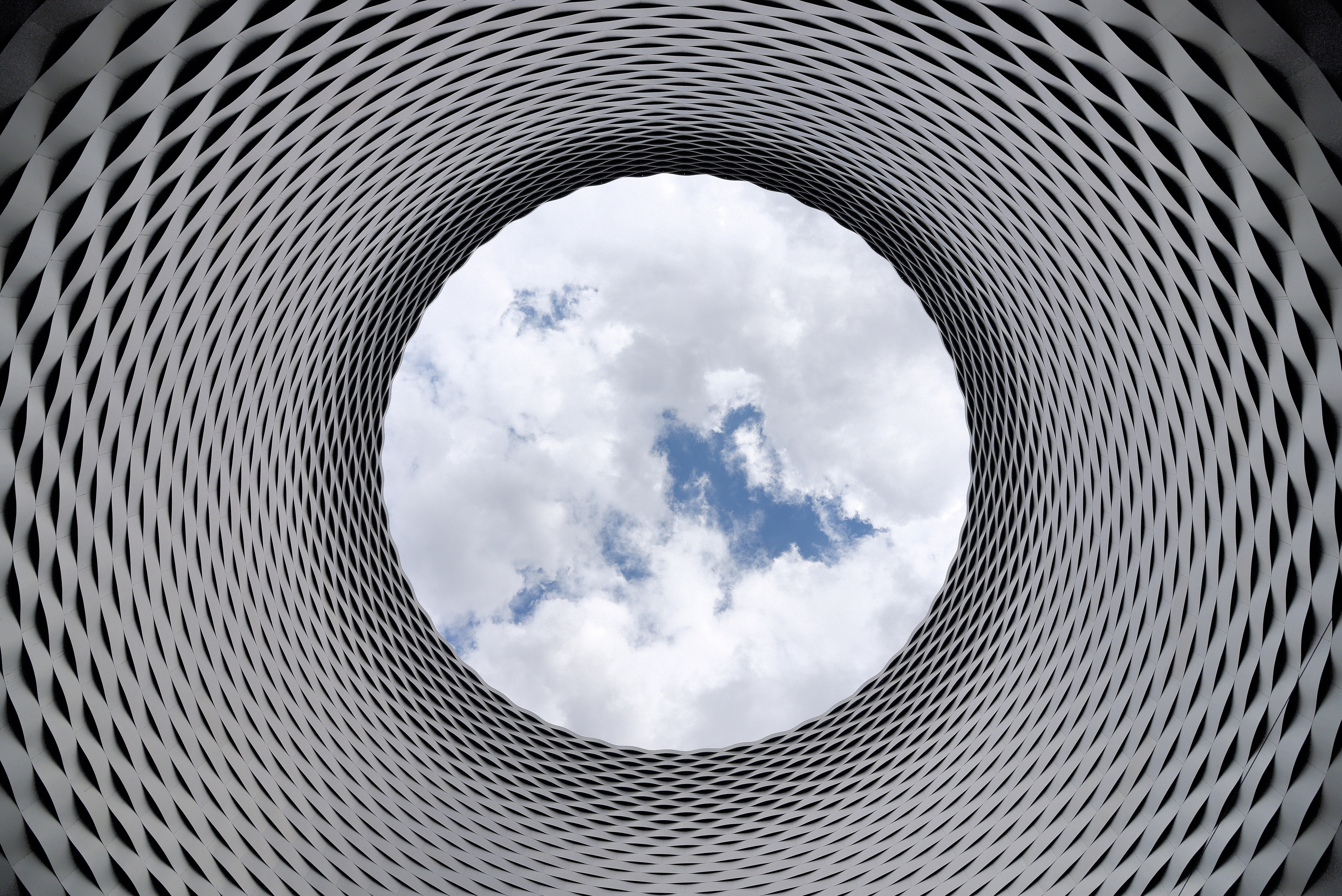 Abstract metal mandala, with sky in centre