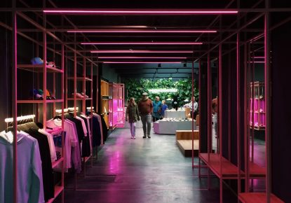 Stylish fashion store illuminated by neon lights