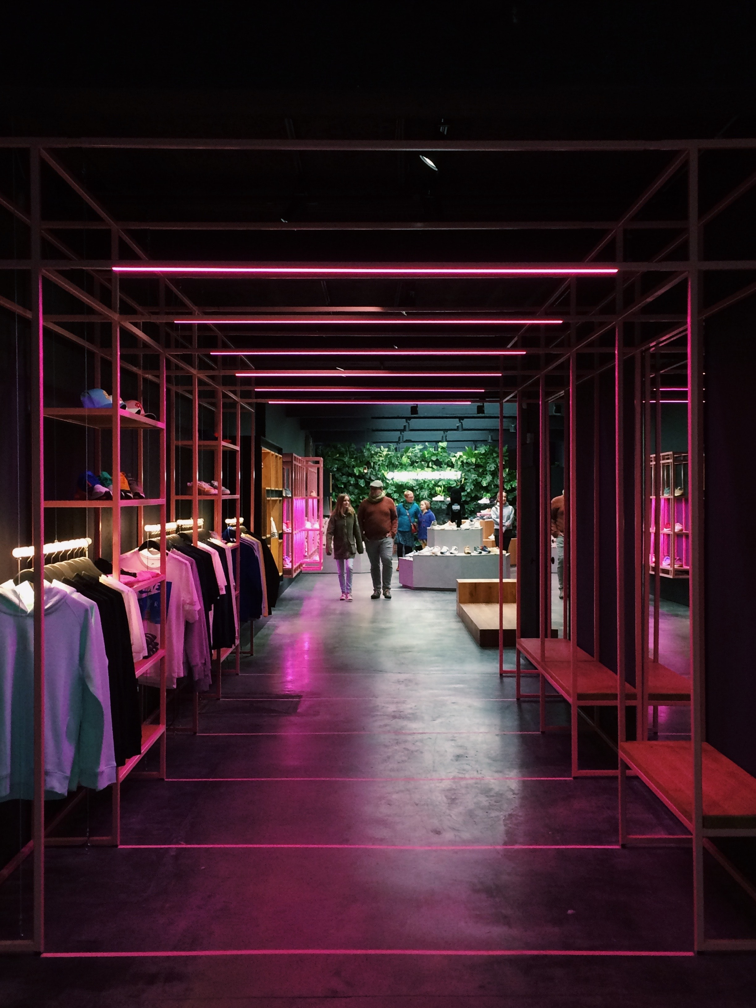 Stylish fashion store illuminated by neon lights