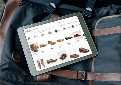 Android tablet displaying brown formal shoes on Google Shopping
