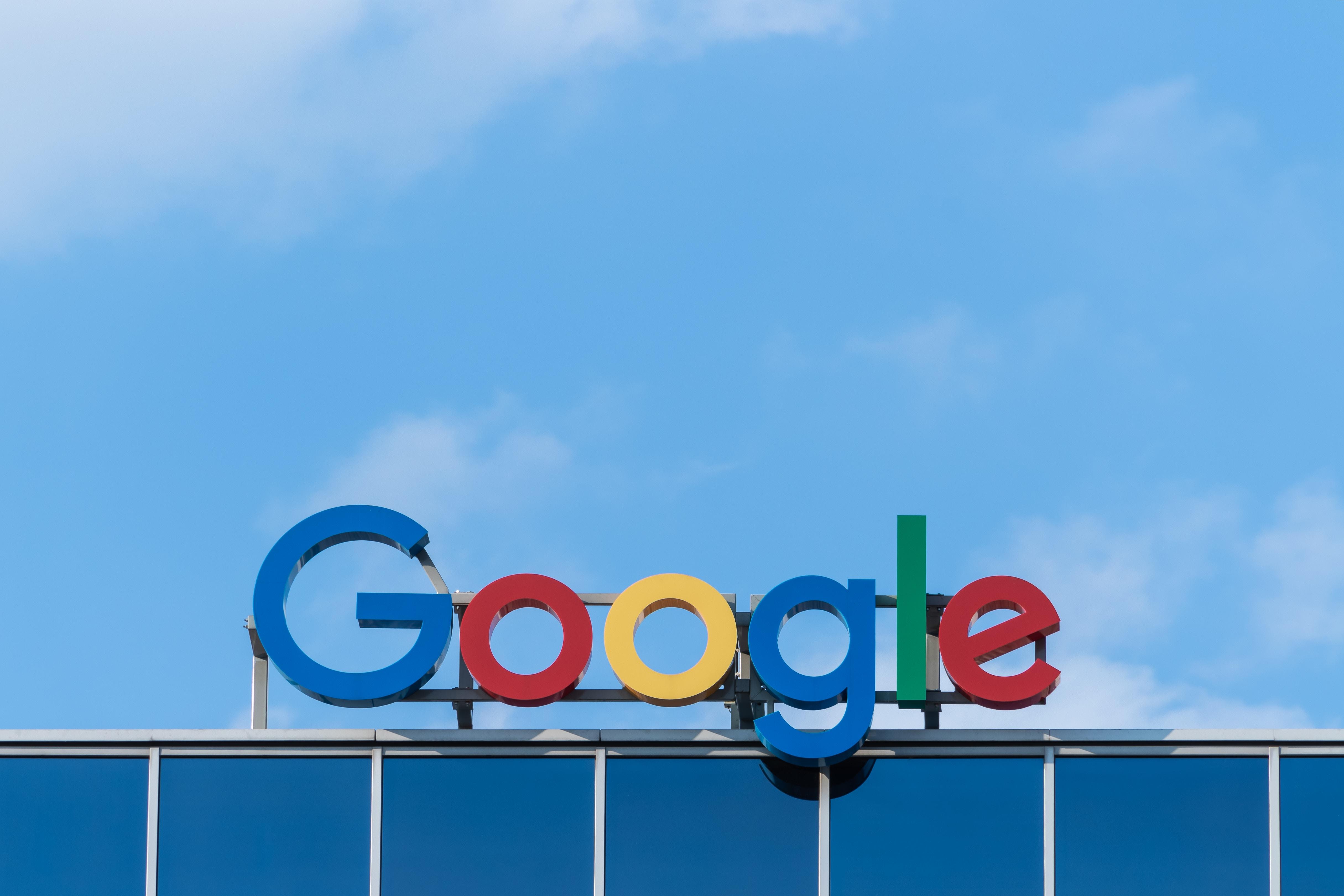 The Google logo, atop a building