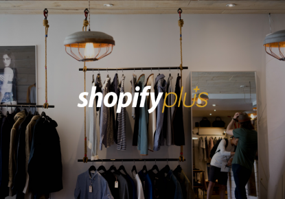 interior of fashion store with Shopify Plus logo in foreground