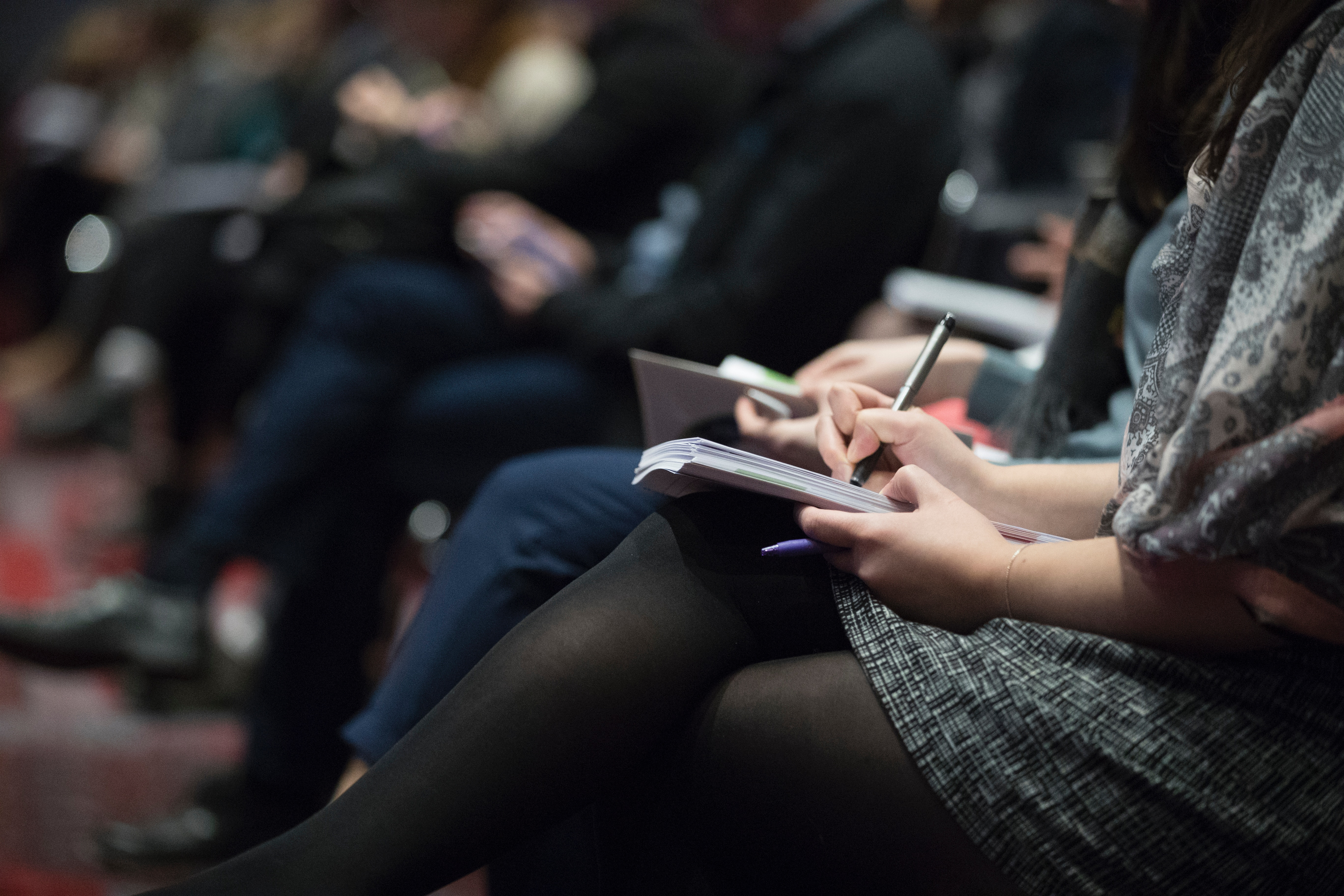 Attendees taking notes at the Shopify Unite event
