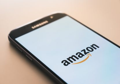 the Amazon app loading on a mobile phone for a customer journey to begin