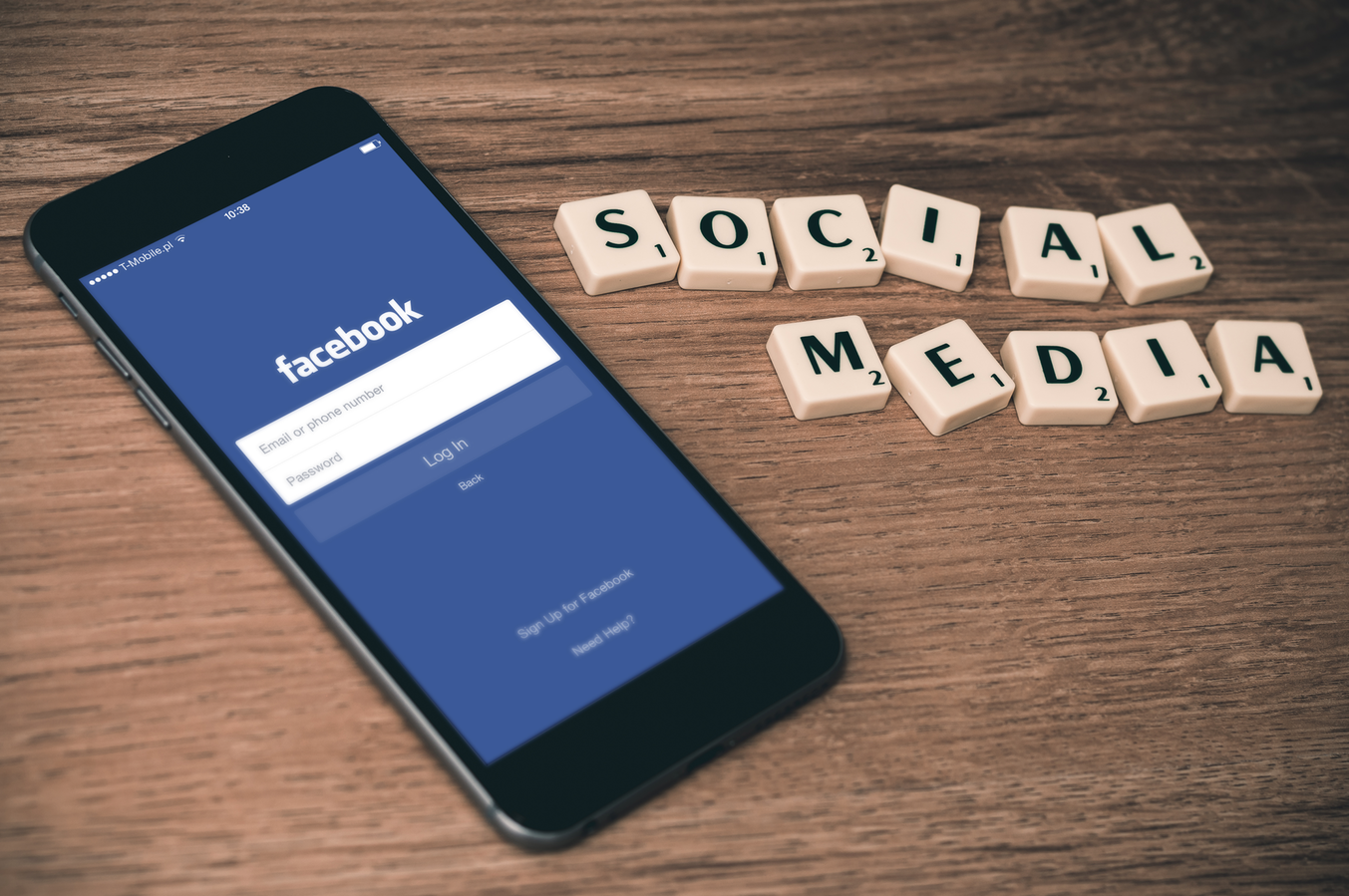 phone with Facebook homepage and social media sign