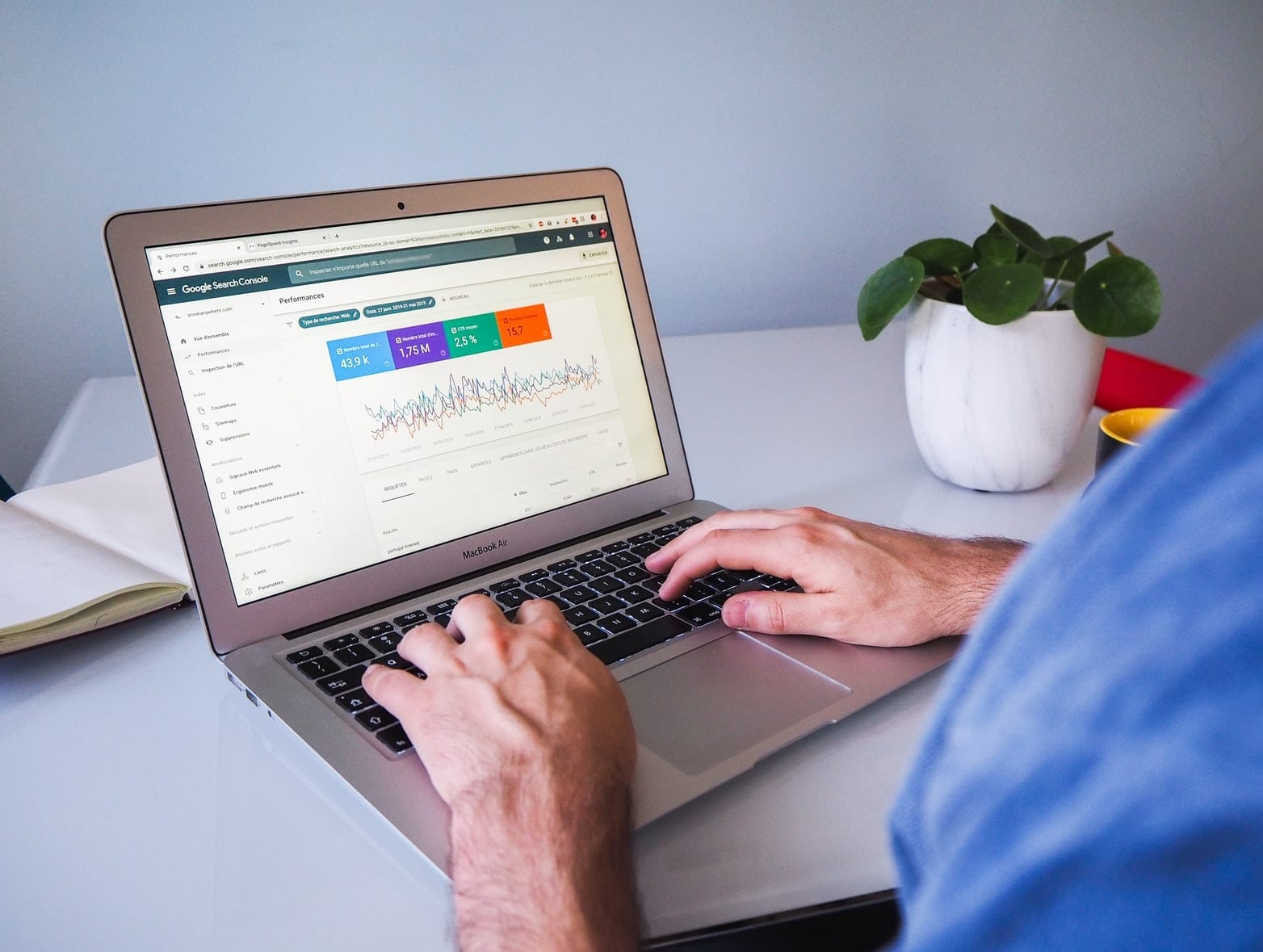 person accessing Google Search Console on a macbook laptop